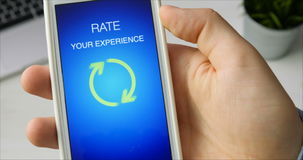 Man gives five star rating using smartphone application stock video
