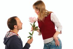 Man gives flower to  woman Royalty Free Stock Image
