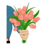 The man gives flowers-01. A man s hand gives a bouquet of red tulips. Flowers for the birthday, 8 March, Valentine s Day, anniversary. For gift cards, banners Stock Photo