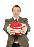 Man gives a gift Stock Images