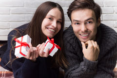 Man Gives a Gift to Woman. Christmas. New Year Royalty Free Stock Images
