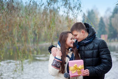 Man gives his girlfriend a gift Stock Photography