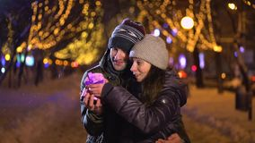 Man gives his girlfriend a gift stock video footage