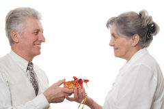 Man gives a lady a gift on a white background Stock Photo