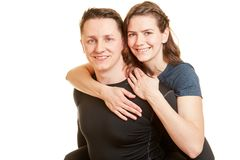 Man gives piggyback ride to woman. Man gives piggyback ride to women in portrait of couple in love royalty free stock photography
