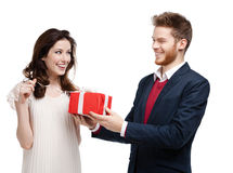 Man gives present to his girlfriend Royalty Free Stock Photos