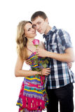Man gives a rose beautiful girl Royalty Free Stock Photos