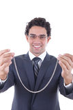 Man gives a silver necklace as a gift Royalty Free Stock Photography