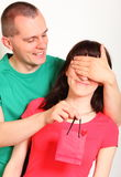 Man gives surprised woman gift for birthday Royalty Free Stock Photos