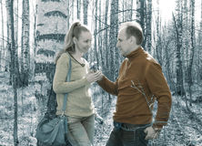 Man gives to the woman a bouquet of snowdrops in a birchwood in the spring, toning Royalty Free Stock Image