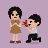 Man gives to the woman flowers Stock Images