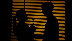 Man gives the woman a decorative heart. Silhouette. Close up stock video footage