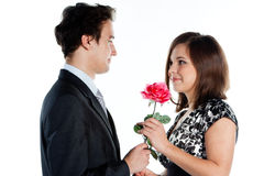 Man gives a woman flowers Stock Image