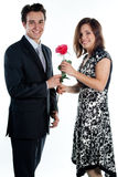 Man gives a woman flowers Stock Photos