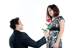 Man gives a woman flowers Royalty Free Stock Photo
