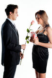 Man gives a woman flowers Royalty Free Stock Images
