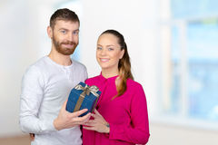 Man gives woman a gift Stock Photo
