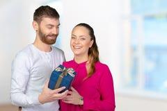 Man gives woman a gift Royalty Free Stock Image