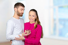 Man gives woman a gift Royalty Free Stock Photography