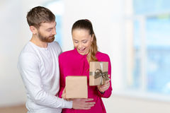 Man gives woman a gift Stock Image