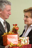 Man gives a woman  gifts Stock Photos
