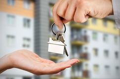 Man gives a woman the keys to a new home Stock Photography