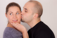 Man gives woman a kiss Royalty Free Stock Photo
