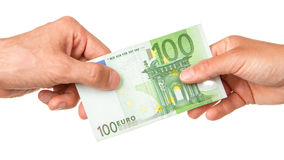 Man giving 100 euro to a woman Royalty Free Stock Image
