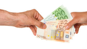 Man giving 450 euro to a woman Royalty Free Stock Photo