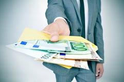 Free Man Giving An Envelope Full Of Euro Bills Stock Photography - 47294912