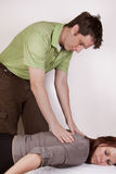 Man giving back massage to woman Stock Photos