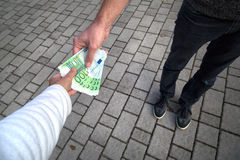 Man giving banknotes euros in the woman hand Royalty Free Stock Photography