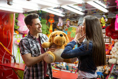 Man giving big teddy bear his girlfriend Royalty Free Stock Images