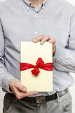 Man giving a book as a present Stock Photos