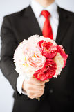 Man giving bouquet of flowers. Close up of young man giving bouquet of flowers Royalty Free Stock Photos
