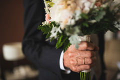Man giving a bouquet of flowers. Man in a suit giving a bouquet of flowers Stock Photo