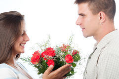 Man giving bouquet of flowers to his girlfriend Royalty Free Stock Image
