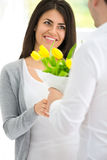 Man giving bouquet of tulips his girlfriends Stock Images