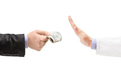 Man giving bribe to a doctor refusing the money Royalty Free Stock Photos