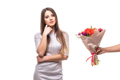 Man giving a bunch of flowers and sad woman isolated Stock Photography