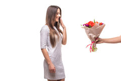 Man giving a bunch of flowers and surprised woman isolated Royalty Free Stock Photos