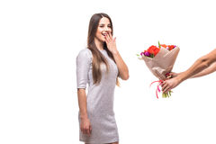 Man giving a bunch of flowers and surprised woman isolated Stock Photos