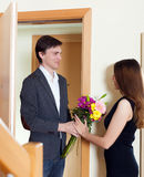 Man giving bunch of flowers to his woman Royalty Free Stock Image