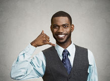 Man giving call me gesture with hand Royalty Free Stock Photos
