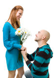 Man giving camomile to woman Royalty Free Stock Photography