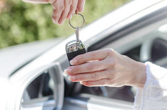 Man giving car key to a woman Royalty Free Stock Photography