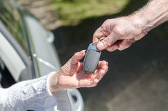 Man giving car key to a woman Stock Photo