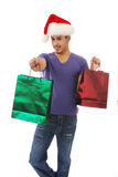Man giving a Christmas gift. A happy smiling man extending a Christmas gift Royalty Free Stock Images