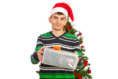 Man giving Christmas gift Stock Image