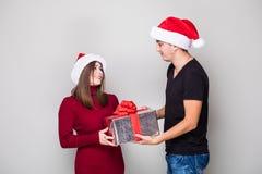 Man giving Christmas gift   woman. Man giving Christmas gift  his woman Royalty Free Stock Image